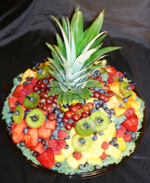 """Fresh Fruit Fantasy"" A spectacular display of Fresh Fruits, hand sliced and artistically arranged. Small $45.00 – Serves 15-20 Large $55.00 – Serves 20-25"